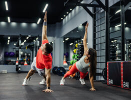 Man and woman doing strength training